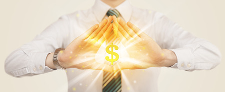 Hands creating a form with shining dollar sign in the center Stock Photo