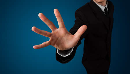 imaginary: Young businessman pressing imaginary button