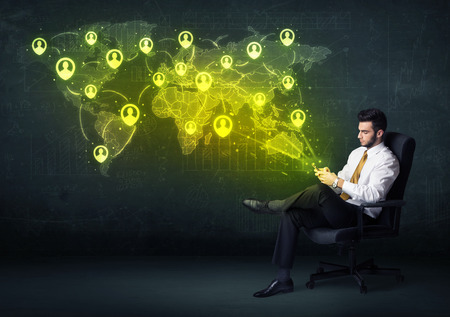 Businessman in office with tablet and social network world map concept on background photo