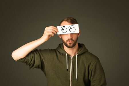 eye balls: Silly man looking with hand drawn eye balls on paper Stock Photo
