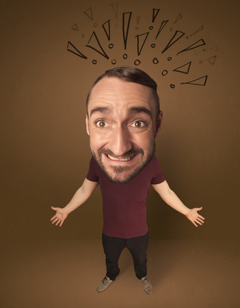 astonished: Funny guy with big head and drawn exclamation marks over it Stock Photo