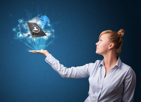 Young businesswoman holding cloud technology in her hand photo