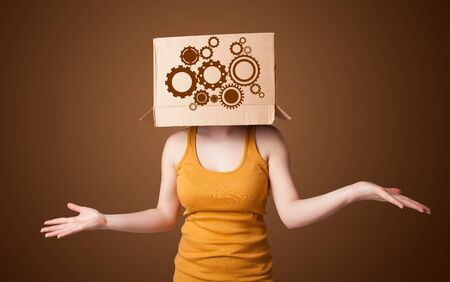 spur: Young woman standing and gesturing with a cardboard box on his head with spur wheels