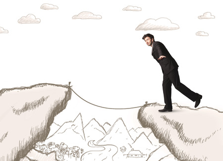 bridging the gap: Businessman standing on the hand drawn edge of mountain Stock Photo