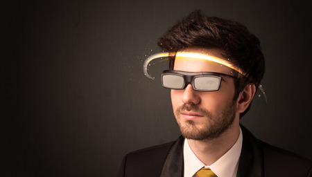 futuristic man: Handsome man looking with futuristic high tech glasses concept