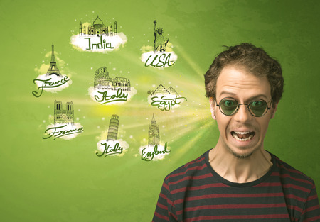 Happy young man with sunglasses traveling to cities around the world concept photo