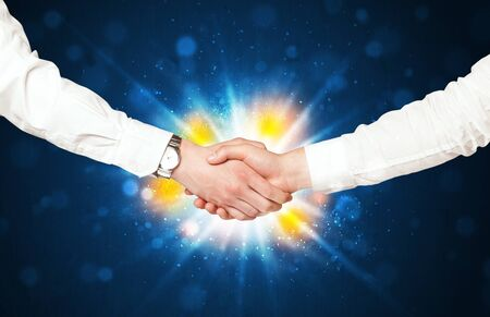 successes: Two business men shaking hands with a successes agreement with explosion