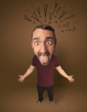 exaggeration: Funny guy with big head and drawn exclamation marks over it Stock Photo