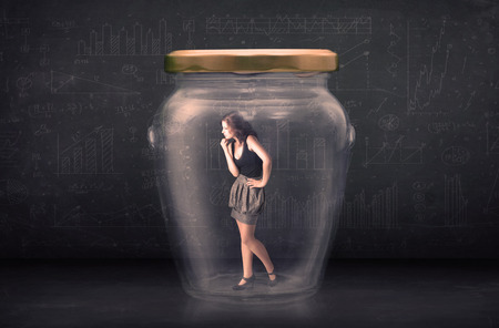 suffocating: Businesswoman shut inside a glass jar concept concept on background
