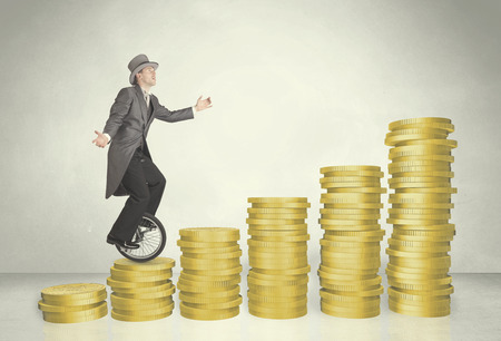 cash cycle: Business man riding monocycle up on coin graph concept on background Stock Photo