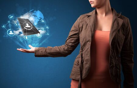 Young woman holding cloud technology in her hand photo