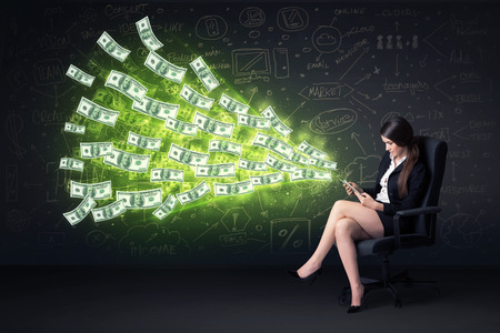 Businesswoman sitting in chair holding tablet with dollar bills coming out concept on background photo