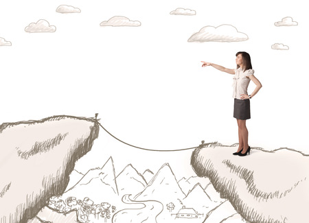bridging the gap: Businesswoman standing on the hand drawn edge of mountain