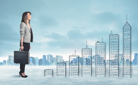 Business woman climbing up on hand drawn buildings in city concept photo