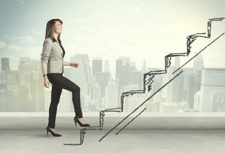 Business woman climbing up on hand drawn staircase concept on city background Standard-Bild
