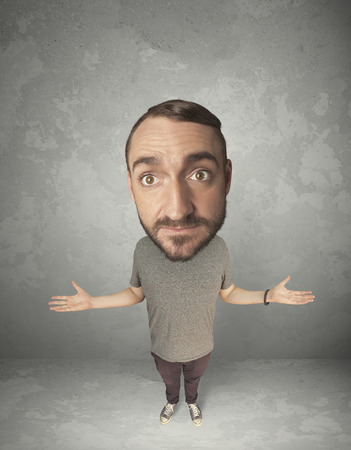 big head: Funny person with big head on gray background