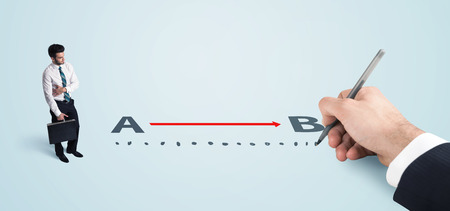 Businessman looking at red line from a to b drawn by hand concept on background photo