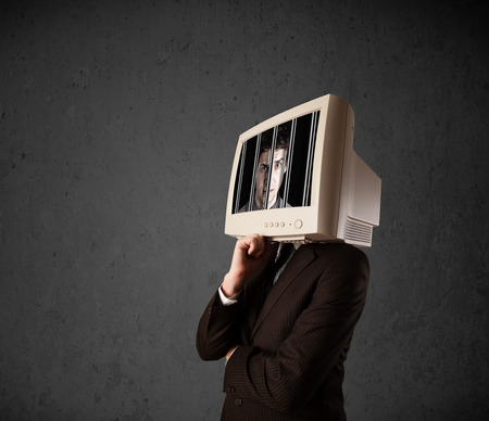 Business man with monitor screen on his head traped into a digital system concept photo