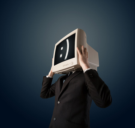 mouth screen: Funny young businessman with a monitor on his head and smiley on the black screen