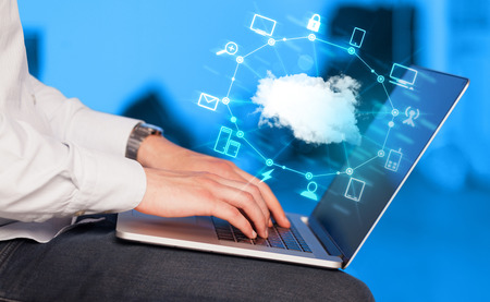 clouds: Hand working with a Cloud Computing diagram, new technology concept