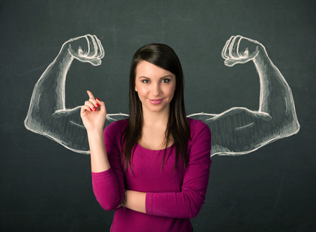 arm muscles: Pretty young woman with sketched strong and muscled arms