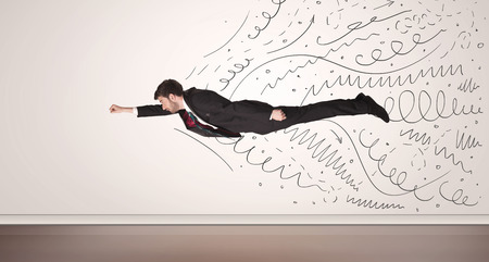 man flying: Business man flying with hand drawn lines comming out concept Stock Photo