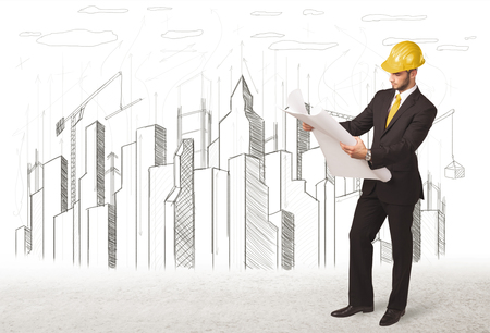 Engineer man with building city drawing in background photo