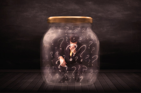 suffocating: Businessman locked into a jar with question marks concept on background Stock Photo
