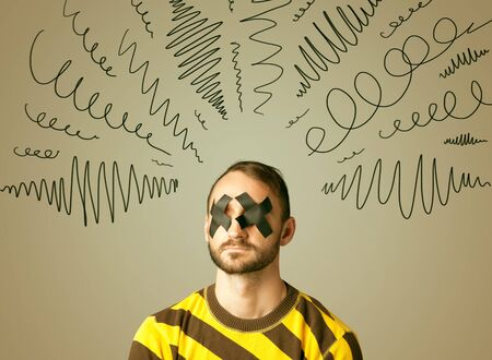 dismay: Young man with taped eye and curly lines around his head Stock Photo