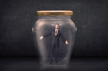 suffocating: Business man closed into a glass jar concept on background