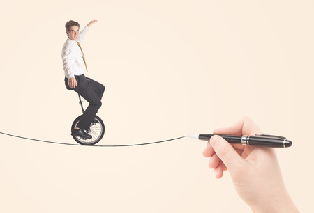 Businessman riding monocycle on a rope drawn by hand concept photo