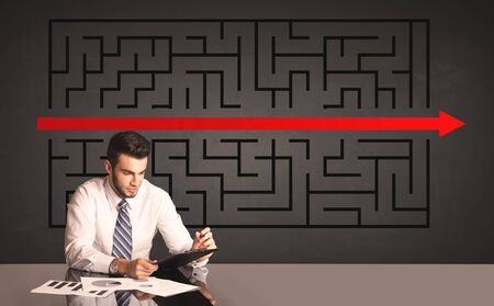 Successful businessman with a solved puzzle in background photo