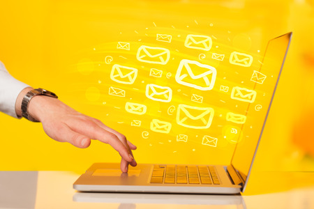 email contact: Concept of sending e-mails from your computer Stock Photo