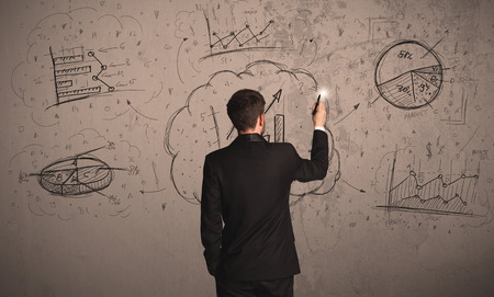 Businessman drawing a business project on a wall photo