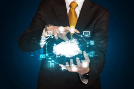 cloud computing: Businessman holding digital icons, Cloud computing concept