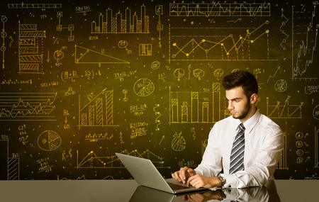 Businessman sitting at black table with hand drawn diagram background photo
