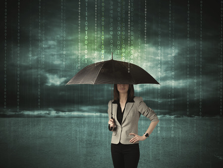 Business woman standing with umbrella data protection concept on background photo