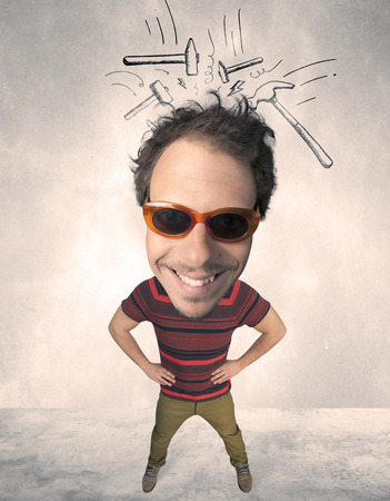 hammer head: Funny person with big head and drawn punching hammers over it Stock Photo