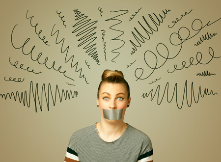 of the mouth: Young woman with taped mouth and curly lines around her head Stock Photo