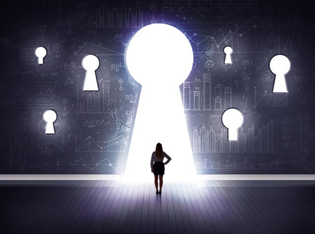 door key: Successful businessman looking through keyhole