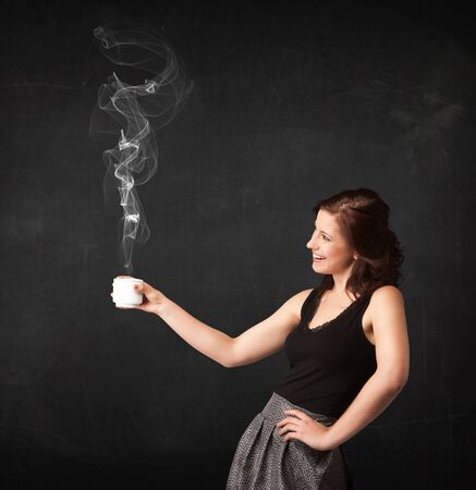 creative force: Businesswoman standing and holding a white steamy cup on a black background