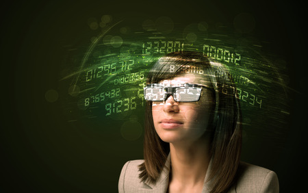 calculations: Business woman looking at high tech number calculations concept