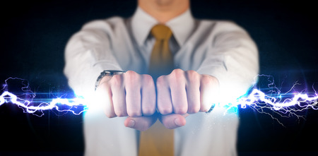 Business man holding electricity light bolt in his hands concept photo