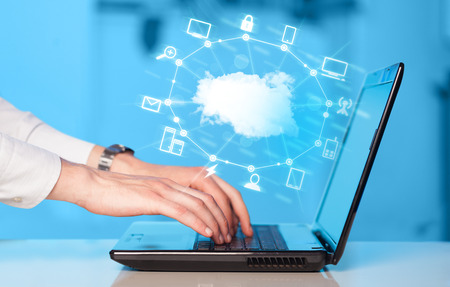 Hand working with a Cloud Computing diagram, new technology concept photo