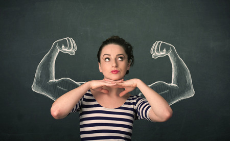 muscled: Pretty young woman with sketched strong and muscled arms