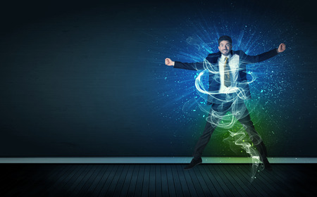 talented: Talented cheerful businessman jumping with glowing energy lines on background Stock Photo