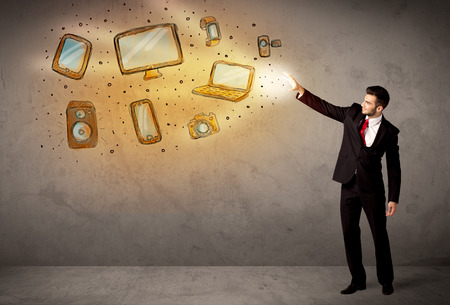 electronical: Man throwing hand drawn electronical devices concept Stock Photo