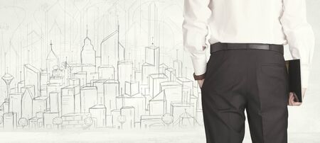 creative force: Businessman from the back in front of a drawn city view