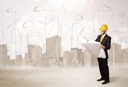 planing: Business engineer planing at construction site with city background concept