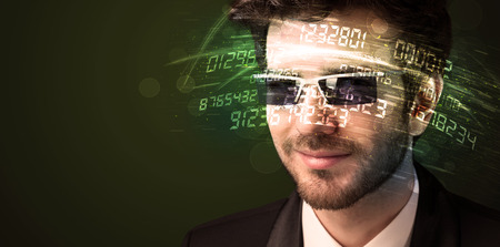 calculations: Business man looking at high tech number calculations concept